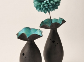 Tall coil-built and incised vessels with flower forms
