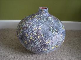 Large coil-built pot with underglaze design